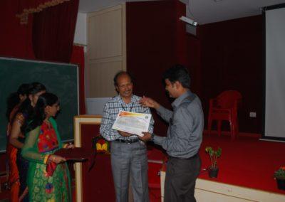 Dr Vijayashankar felicitating Dr CSBR Prasad